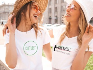 Portrait of two young beautiful blond smiling hipster girls in trendy summer white t-shirt clothes. Sexy carefree women posing on street background. Positive models having fun in sunglasses and hat